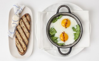 Eggs in a pan with toasted bread